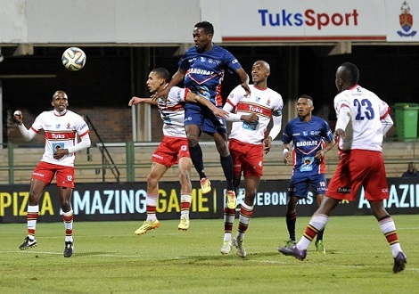 NMMU Madibaz's Lukhanyo Rasmeni challenges a sea of Tuks players during their final Varsity Football match on Monday night. Tuks beat the Madibaz 4-0 to advance to the semifinals. Photo: Catherine Kotze / Saspa