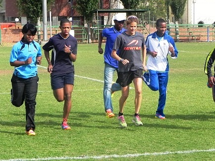 Mrs Zola Budd Pieterse with some of the athletes and recipients of running shoes. Photo: Supplied