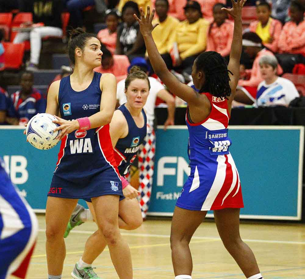 SPAR Madibaz netball captain Mione Marais (front) and Madibaz vice captain Arne Rust (back) helped take their team to a 70-29 victory against the Vaal University of Technology in round three of the 2015 Varsity Netball tournament on Monday. Photo: SASPA