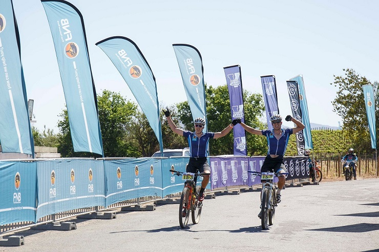 UCT's Luke Evans (left) and Martin Freyer cross the finish line first on the second day to win the overall men's title at the FNB-sponsored Varsity MTB Challenge, which started and finished at Nederburg near Cape Town today.