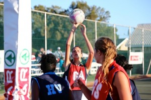 SPAR-NMMU's Eileen van Zyl takes aim during the season-opening SPAR-NMMU Netball Tournament at the 2nd Avenue Campus in Port Elizabeth on Saturday. The hosts won three of the five pool finals, as well as the men's section. Photo: Richard Huggard
