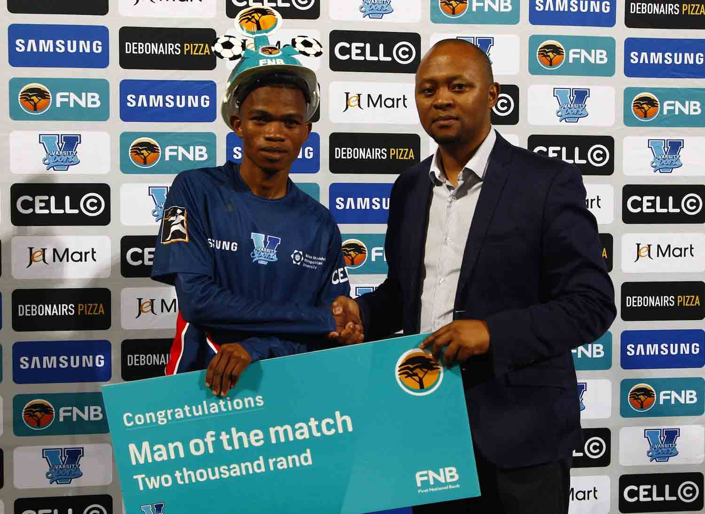 Madibaz centre midfielder Karabo Motlhabi accepts the award for FNB Man of the Match in the Varsity Football clash between NMMU and Walter Sisulu University in Port Elizabeth on Thursday night. Photo: Michael Sheehan/Saspa