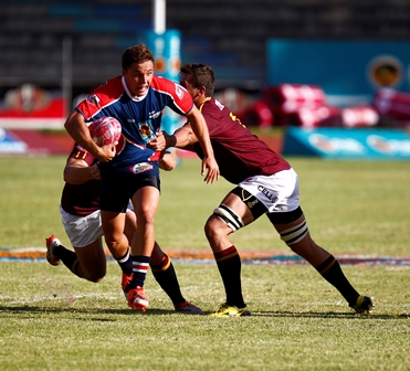 Simon Bolze of Madibaz tackled during their FNB Varsity Cup match against Maties. Photo: Saspa