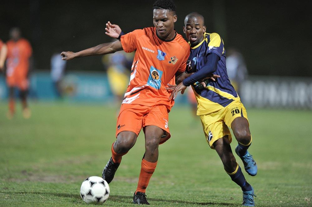 Ntokozo Tshabalala of UJ (left) is challenged by Nhlanhla Manana of UWC in their Varsity Football clash in Cape Town on August 15. Photo: Saspa