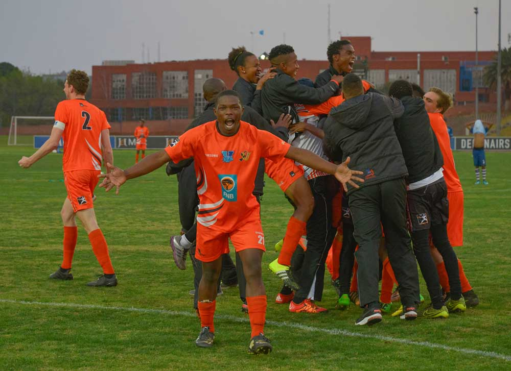 University of Johannesburg player Sbongeleni Gamede and his team-mates celebrate after winning their Varsity Football semi-final shoot-out over Central University of Technology in Bloemfontein. Photo: Saspa