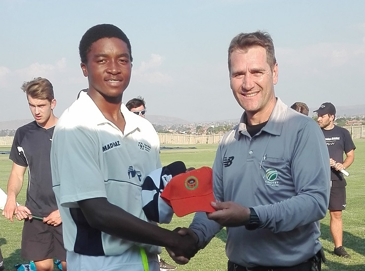 Madibaz cricketer Lutho Sipamla (left), who was selected for the national team after the USSA tournament in Pretoria, receives the man of the match award for his performance against Free State from umpire Andre Fourie.