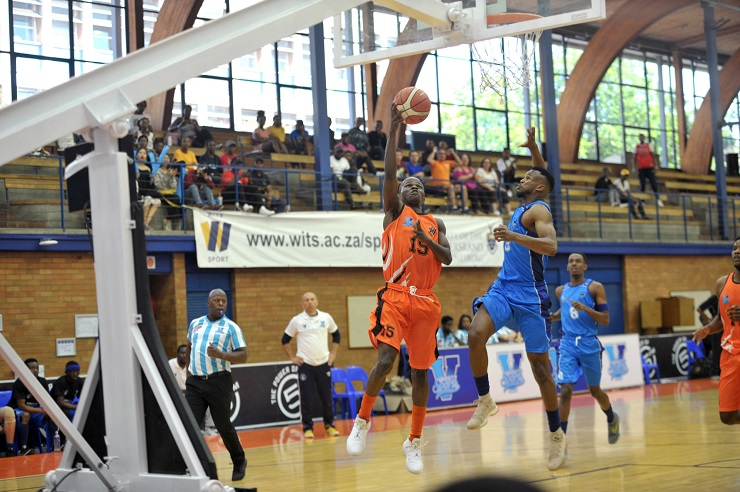 University of Johannesburg's Lance Chikore (left) shoots for goal during their Varsity Basketball match against UCT